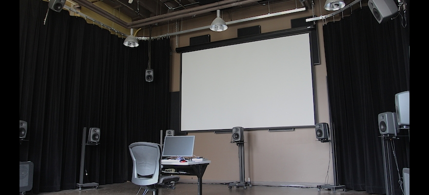 Forward view of retractable screen and curtains in Room 205 Media Lab