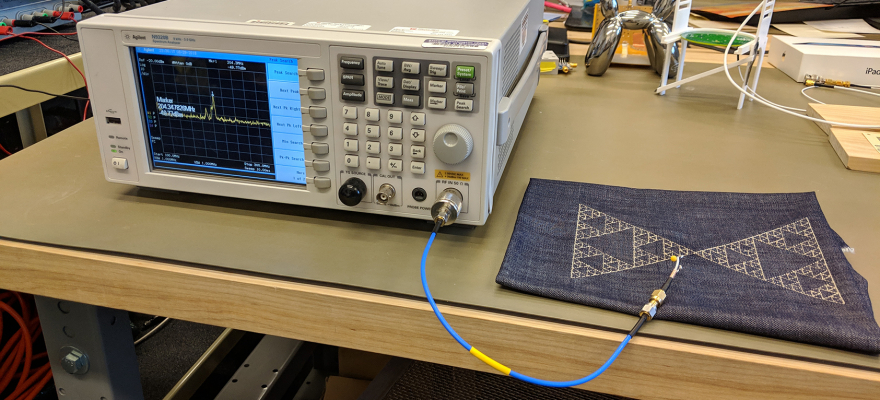 Embroidered Sierpinski Triangle antenna resonant frequency measurement with Spectrum Analyzer  at the Reynolds Lab in Electrical Engineering