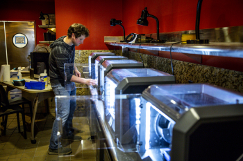 A student printing masks at DXARTS' McMahon FabLab (Dennis Wise/UW)