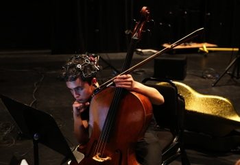 "Cellist Jay Campbell of JACK Quartet checks sheet music during a rehearsal break at the ""brain-art initiative"" at Meany Studio Theater. (Alan Berner/The Seattle Times)"