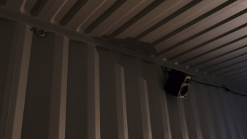 Speaker in a shipping container