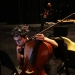 """Cellist Jay Campbell of JACK Quartet checks sheet music during a rehearsal break at the """"brain-art initiative"""" at Meany Studio Theater. (Alan Berner/The Seattle Times)"""