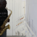 Warren Neidich playing the saxaphone